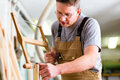 Carpenter using hand saw Royalty Free Stock Photo