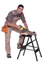 Carpenter using a handsaw on workbench Royalty Free Stock Photography