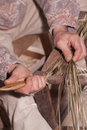 Carpenter weaves straw Stock Photo