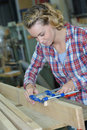 Carpenter woman working in workshop Royalty Free Stock Photo