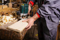 Carpenter at work with electric planer joinery the hands when working Royalty Free Stock Photos