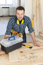 Carpenter at work portrait of handsome construction worker Stock Image