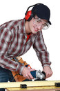 Carpenter at work on workbench young Royalty Free Stock Image