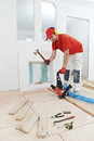 Carpenter worker joining parket floor Stock Photography