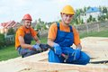 Carpenter workers on roof construction carpenters crew installation work Royalty Free Stock Image