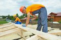Carpenter workers on roof construction carpenters crew installation work Royalty Free Stock Photography