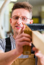 Carpenter working with angle in his workshop or carpentry Stock Photos