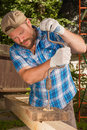 Carpenter working by hand drill Royalty Free Stock Photo
