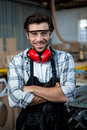 Carpenter working on his craft in a dusty workshop Stock Photography