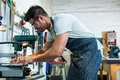 Carpenter working on his craft in workshop Royalty Free Stock Image