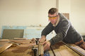 Carpenter working job using table saw Royalty Free Stock Photography
