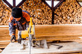 Carpenter working. Man cutting plank by circular saw. Royalty Free Stock Photo