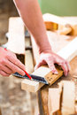 Carpenter with workpiece in carpentry working on wooden his workshop or Royalty Free Stock Photos