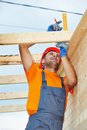 Carpenter works on roof construction worker measuring wood board with angle installation work Royalty Free Stock Photography