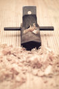 Carpentry of wood planer closeup and woodchips woodworking concept Stock Photo