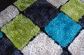 Carpet texture in multicolors on the floor Stock Photography