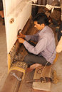 Carpet weaving jaipur india april th a male artisan hand a Stock Photo