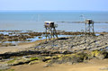 Carrelets at saint michel chef chef in france fishing from low tide and the town of nazaire the background pays de la loire Stock Images