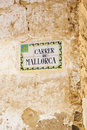 Carrer de mallorca street name old painted sign on a spanish stone wall Stock Photo