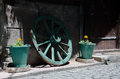 Carriage wheel and flower pots Royalty Free Stock Photo