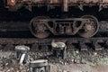 Carriage wheel on railway tracks closeup. old iron transportatio Royalty Free Stock Photo