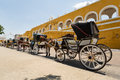 Carriages in izamal yucatan mexico april horse lining up on the street of pueblo magico Stock Image