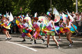 Carribean festvial dance group of rainbow dancers at a festival Royalty Free Stock Photos