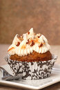 Carrot cake cupcake with cream cheese frosting Royalty Free Stock Images