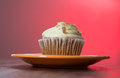 Carrot cake cupcake with red background light Stock Images