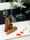 Carrot cake dessert with cherry sauce Royalty Free Stock Photo