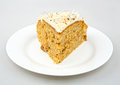 Carrot cake with nuts in white plate Stock Images