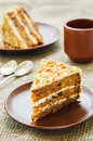 Carrot cake with walnuts prunes and dried apricots on a dark background tinting selective focus Stock Image