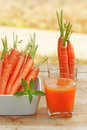 Carrot juice fresh and carrots Stock Photography