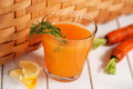 Carrot juice in the glass on white table Stock Image