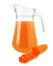 Carrot juice in a jug on a white background Stock Photos