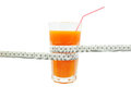 Carrot juice and meter on white background Royalty Free Stock Images
