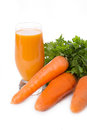 Carrot juice and vegetable with greens over white Royalty Free Stock Photography