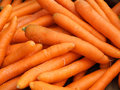 Carrot pile close up of orange presenting fresh vegetables Royalty Free Stock Images
