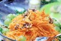 Carrot salad with nuts and grapes Royalty Free Stock Photo