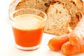 Carrot set with juice carrots and carrot bread close up Stock Images