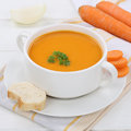 Carrot soup with fresh carrots in bowl healthy eating Royalty Free Stock Photo