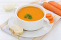 Carrot soup with fresh carrots in bowl Royalty Free Stock Photo