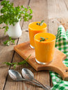 Carrot soup sream in glass Royalty Free Stock Photography