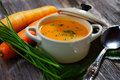 Carrot soup wooden background Royalty Free Stock Photo