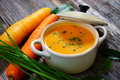 Carrot soup wooden background Royalty Free Stock Images