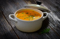 Carrot soup on wooden background Royalty Free Stock Image