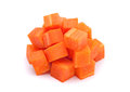Carrot vegetable cube heap isolated on white background Royalty Free Stock Photo