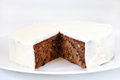 Carrot and walnut cake with marzipan icing piece missing Royalty Free Stock Image