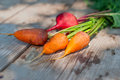 Carrots and beets on a wooden table Royalty Free Stock Photo