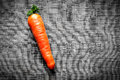 Carrots on black fabric background a synthetic Royalty Free Stock Photography